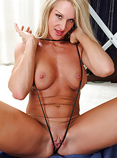 Horny blonde MILF Ingrid spreads her pussy after she finishes her chores