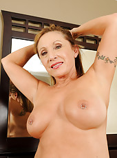 Fuckable and horny 69 year old Luna preads her pierced pussy wide