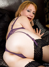 46 year old Tiffany T in purple lingerie spreading her pussy wide