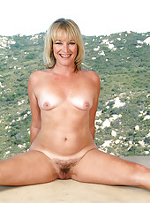 Popular blonde MILF Tina from AllOver30 poses at the top of the world