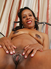 Ebony MILF Sunshine M flaunts her dark and meaty pussy for you