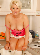 Blonde Sally T from AllOver30 plays with her pierced pussy in here