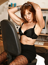 Redheaded MILF Georgie from AllOver30 displays hairy pussy