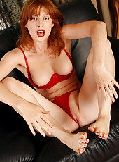 Redheaded MILF Amber D from AllOver30.com plays with her feet