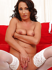 36 year old Sandy K posing and spreads wide in white lacey stocking