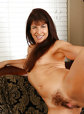 Brunette Andie from AllOver30 spreads her moist hairy pussy wide