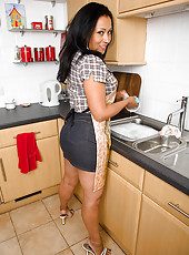 Beautiful and busty Danica from AllOver30 shows off in the kitchen