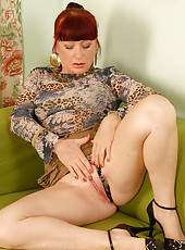 Redheaded Esmeralda splits her pussy with her blank thong