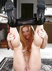 Elegant redheaded MILF Michelle M spreading her long long legs
