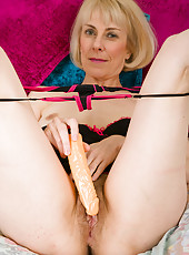 Blone Haze stuffs her 52 year old pussy with a big plastic dick