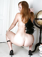 Michelle M plays maid before stripping and spreading her long legs