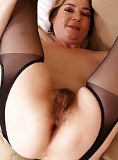 42 year old Eszti in stockings spreading her hairy pussy wide for you