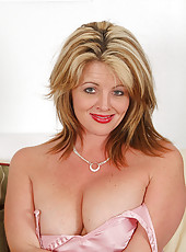 Busty Sherry V slips off her clothes and probes her pink mature pussy