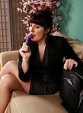 Brunette MILF Ava from AllOver30 slips her purple toy deep inside her