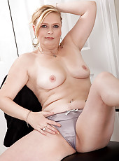 Feature mature model Tamara strips after dusting the table