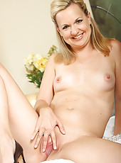 Perky MILF Hannah S slips off her purple lingerie and spreads