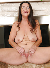 Elegant 51 year old Tia from AllOver30 slips out of her evening dress