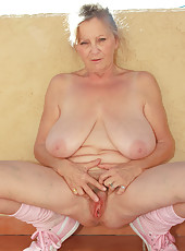 At 64 years old Isabel from AllOver30 loves to stretch her mature box