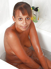 Exotic 36 year old MILF Christing soaps up her hairy pussy in here