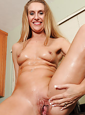 Hot blonde Sara J gives us a wet tshirt showing before showing all