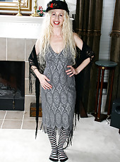 Long haired blonde MILF spreads in her knee high striped socks