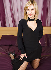 Hot blonde MILF Laurita showing off her black stockings in here