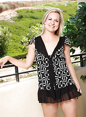 Blonde MILF Hanna S from AllOver30 teases us on the balcony