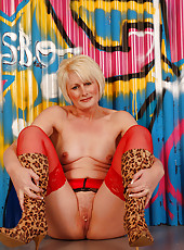 Gorgeous MILF Sally T in red panties and see through top posing
