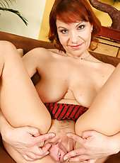 Red headed housewife shows off her wares from her couch