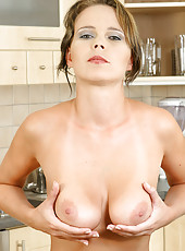 Busty blonde housewife spreads her mature pussy in the kitchen