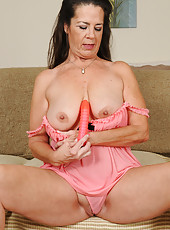 51 year old Tia from AllOver30 plunging her toy deep in her pussy