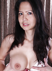 Exotic Ruby Grace from AllOver30 stuffs her mature box with toy