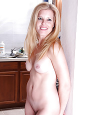 Gorgeous housewife Gail gets things heated right up in the kitchen