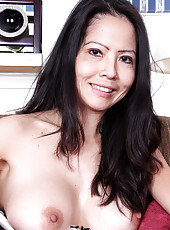 Ruby Grace from AllOver30 slips out of her hot lingerie and spreads