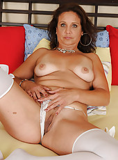 43 year old Chane looking super sexy in her lace and white stockings