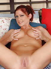 32 year old redheaded housewife spreads her shaven pussy wide