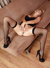 Long and lean Cherie Deville in stockings and lace revealing everything