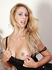 32 year old Cherie Deville in a elegant black dress strips on camera