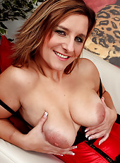 Josefa shows off her massive mature boobs and rubs her pussy