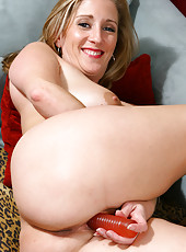 Big titted MILF with a shaved pussy toys her shaven hole in here