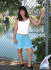 Strolling through the park Andie decides to flash her mature pussy