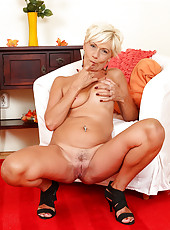 45 year old blonde Katie Hood spreads her legs and squeezes tits