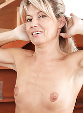 47 year old housewife Darling takes a break from her chores to tease