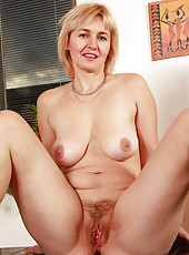 Sexy blonde housewife with large natural tits spreads her moist beaver