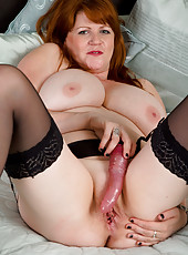 Redheaded plumper MILF stuffs a dildo deep into her older snapper