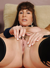 Sexy 47 year old Alexandra Silk tugging at her hot pussy hairy in here