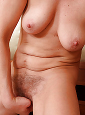 Horny Liz M dipd her fingers into her mature 44 year old mound here