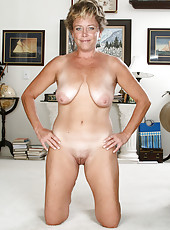 42 year old Ariel from AllOver30 spreads her mature shaven pussy