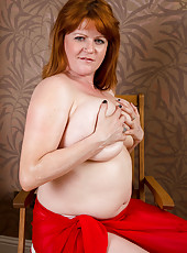 Redheaded BBW Lucy Jo swings her mammoth bangers around in here
