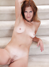 Elegant MILF Jay Dee undresses and spreads her mature pussy here